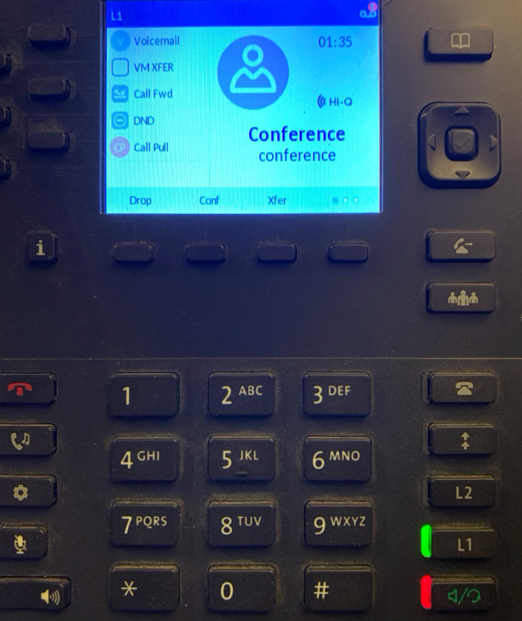 Phone screen displaying you are in conference